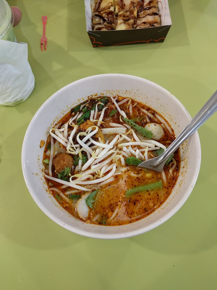 bowl of spicy thai noodle soup at platinum mall