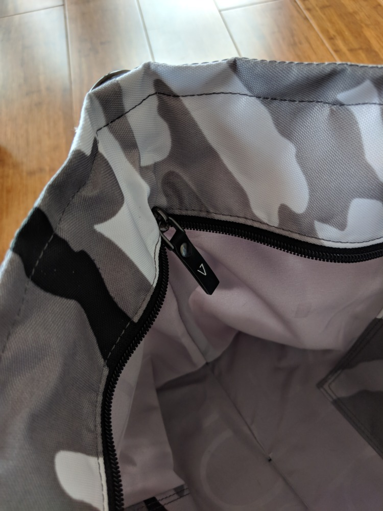 Andi Bag Review: Winter Camo and Quartz Pink zipper detail