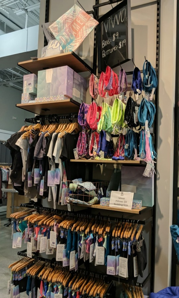 Ivivva wall filled with accessories and clothing for young girls.