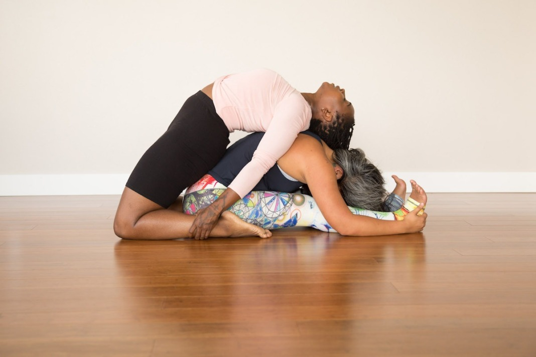 Supporting each other in Kapotasana and Forward Fold.