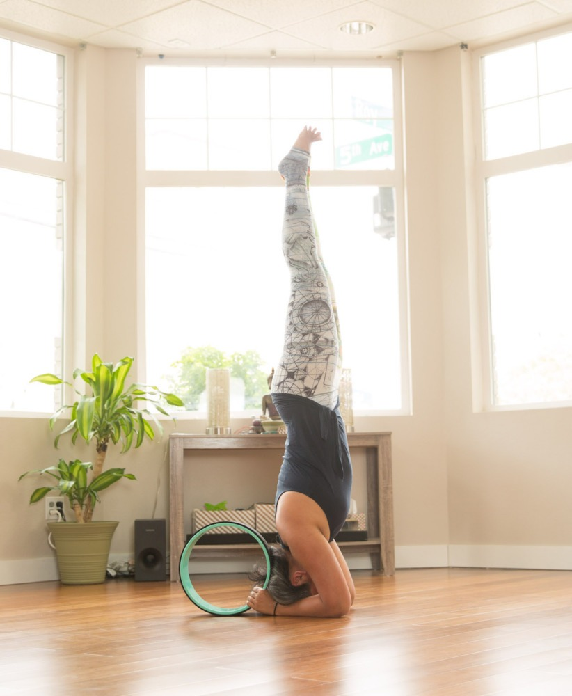 Salamba Sirsasana or Headstand with a Yoga Wheel