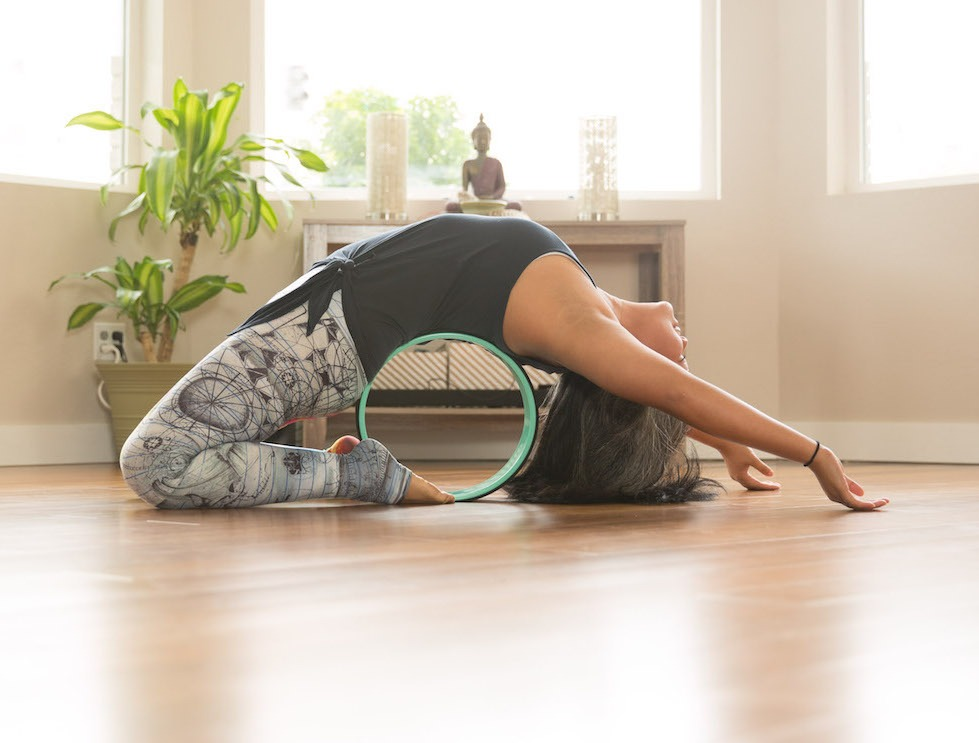 Kapotasana or King Pigeon with a Yoga Wheel