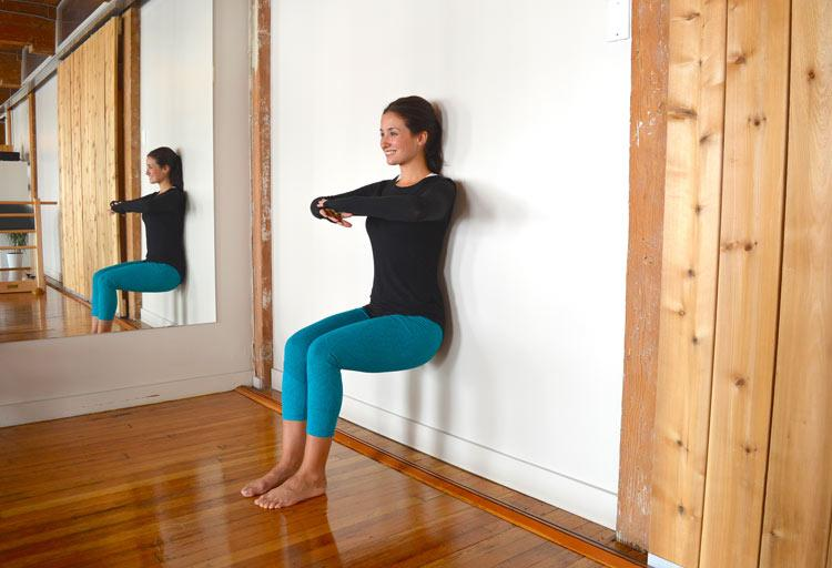 wall supported chair pose yoga for stronger knees schimiggy reviews
