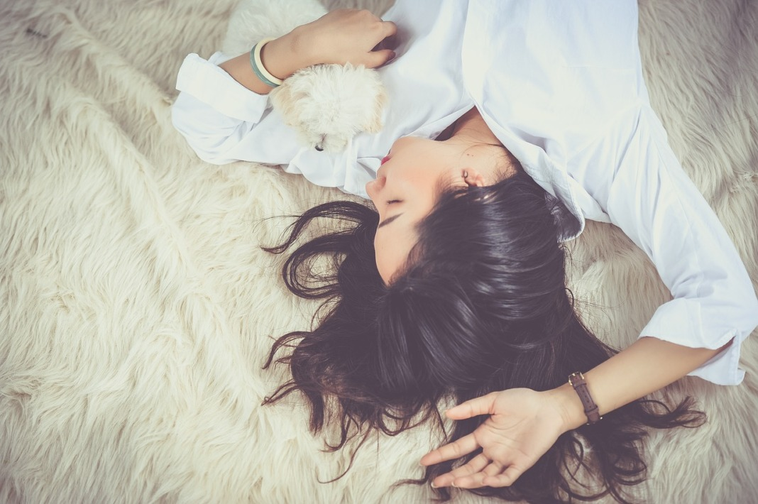 woman taking nap with dog