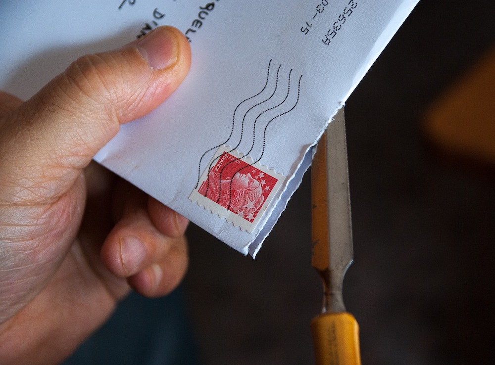 mail letter being opened