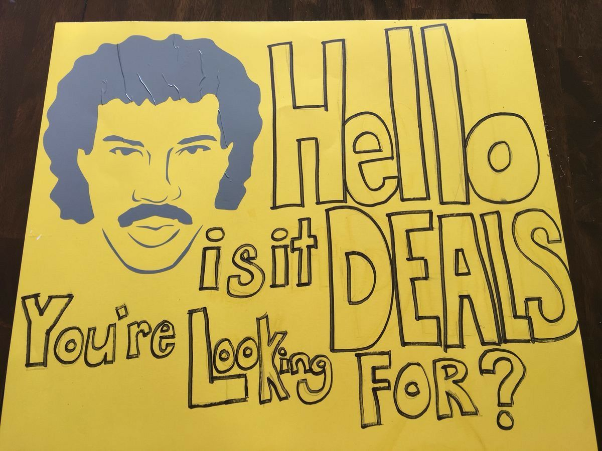 garage sale sign lionel richie hello
