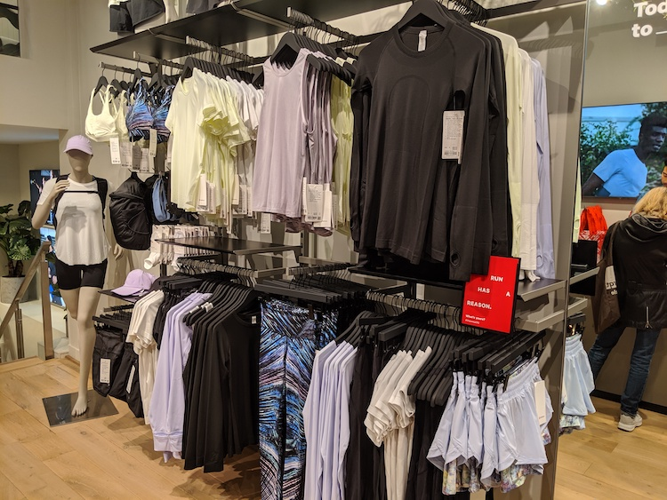 lululemon amsterdam store and product photos womens tops and bottoms wall