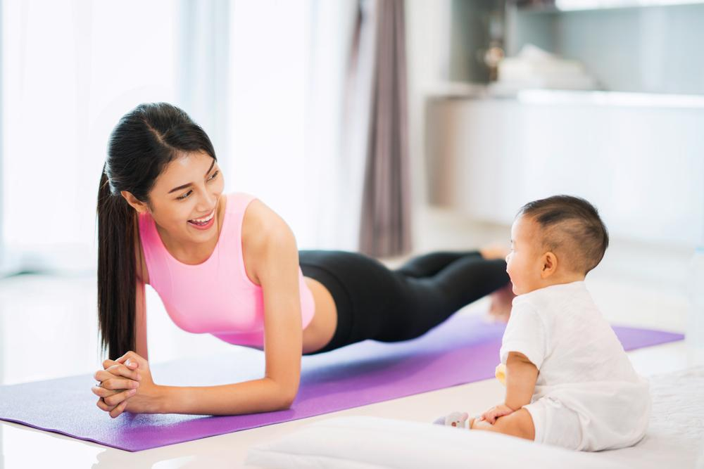 mom and baby doing yoga plank pose