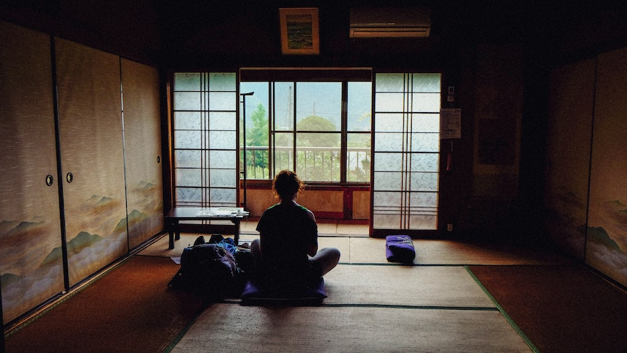 seated yoga pose looking outside window