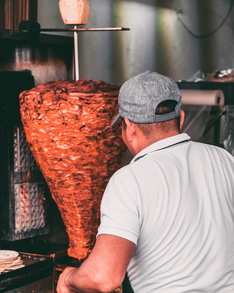 tacos al pastor spit meat and food in mexico city