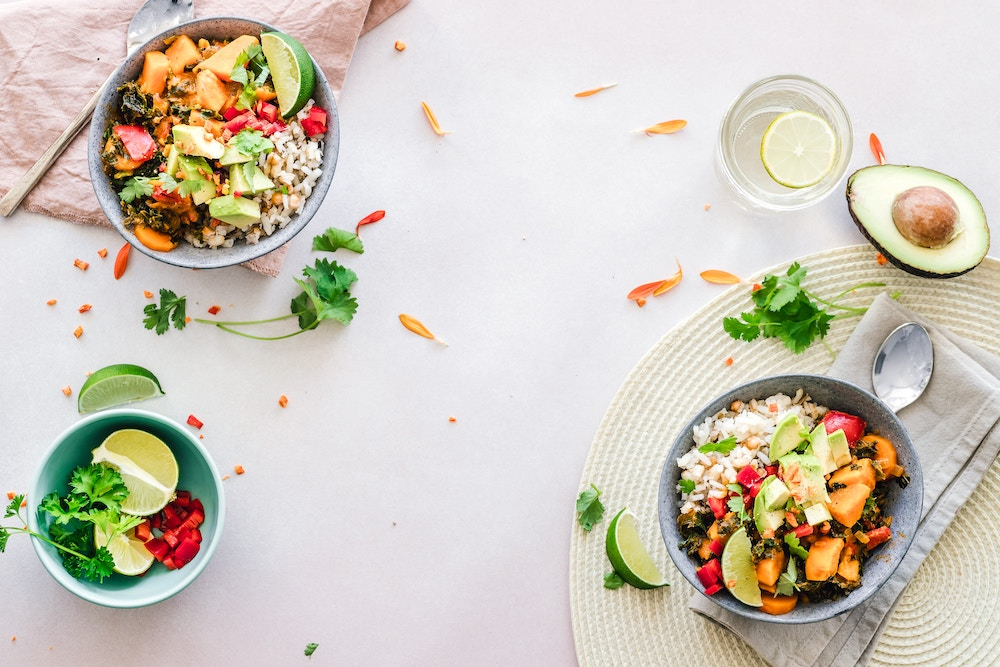 healthy meal bowls with avocado pumpkin and quinoa