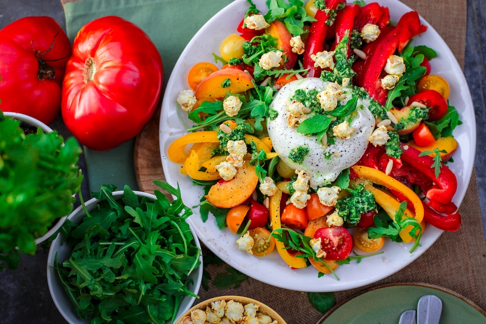 healthy meal colorful salad bowl with bell peppers and tomatoes