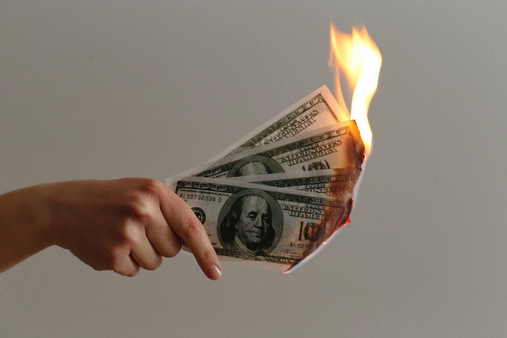 money burning losing cash over financial mistakes