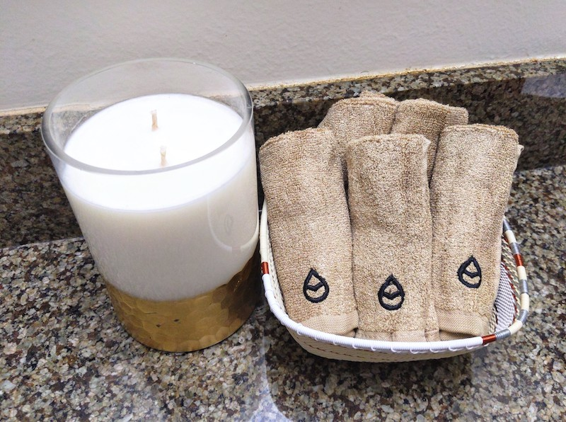 tushy towels in basket with candle