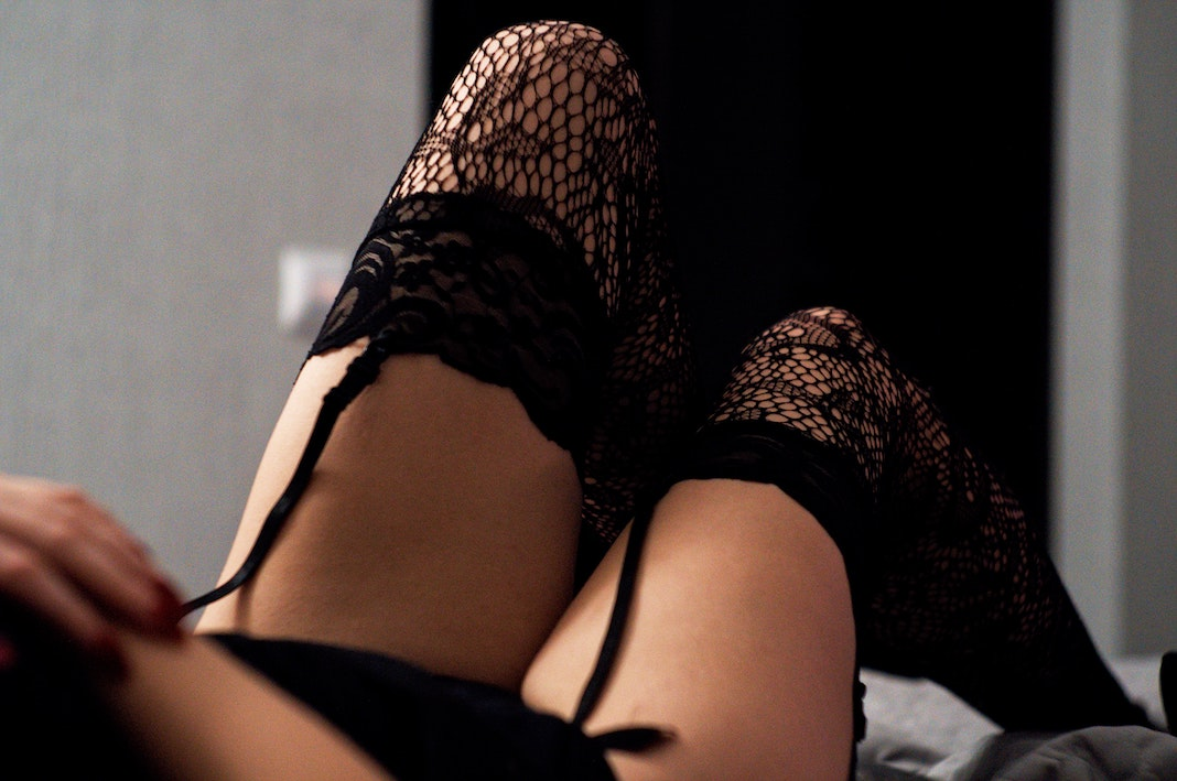sexy woman wearing lace stockings on bed