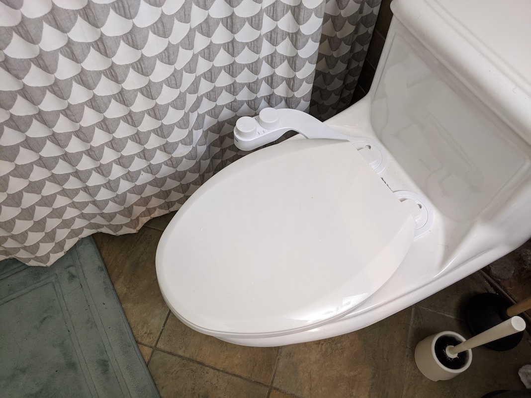 omigo element plus bidet attached to toilet