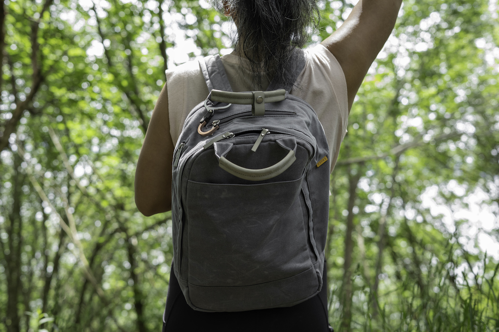 wearing day owl backpack on a hike