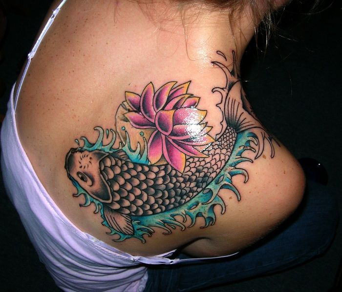 koi fish tattoo on shoulder and back