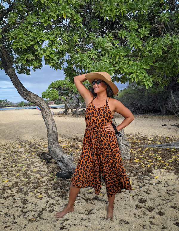 hawaii outfit idea leopard print romper with wide brim straw hat