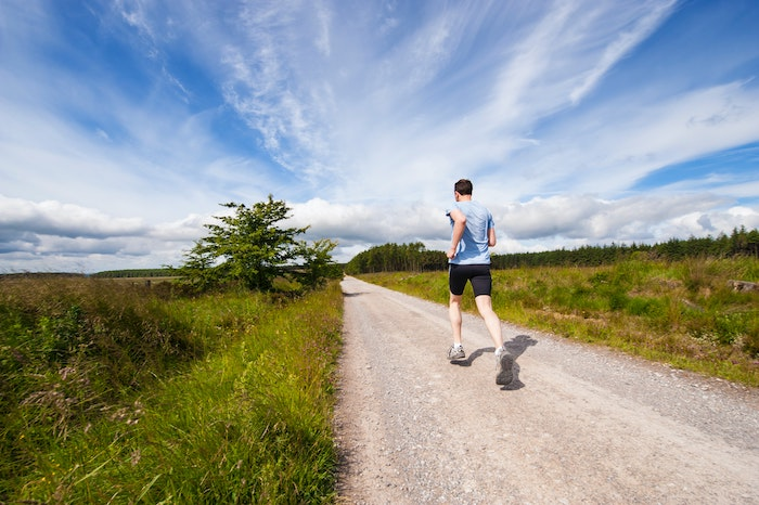 healthy man running outdoors