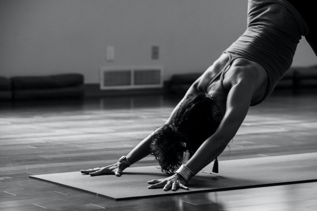 downward dog in black and white