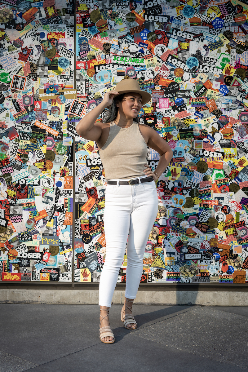 neutral spring outfit with everlane white jeans and furtalk felt hat and alohas sandals