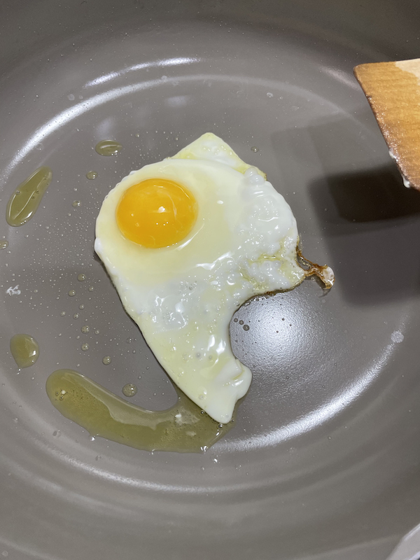 cooking fried egg on our place always pan
