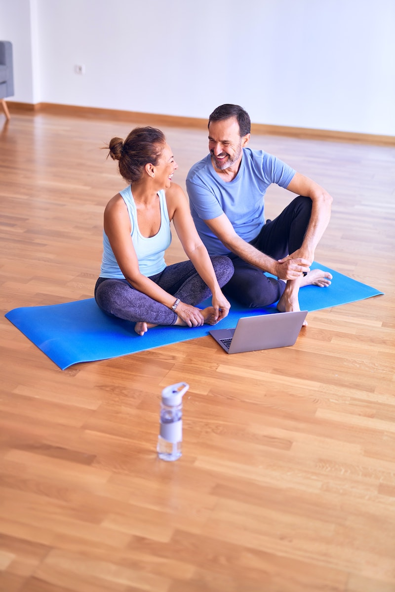 couple in yoga class laughing and smiling