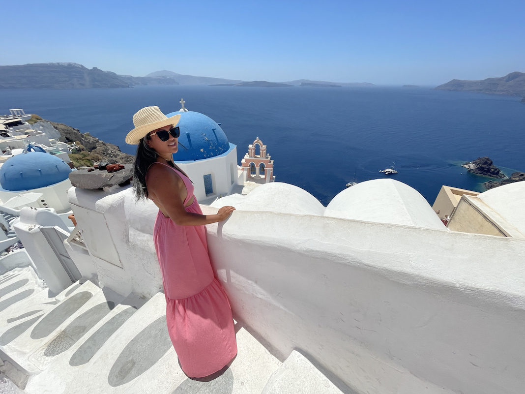 bright pink dress outfit in oia santorini